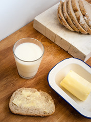 buttered bread with glass of milk