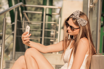 girl  taking photos with a teletphone