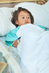 Sick little girl in hospital bed
