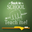 Pencil in the fist on the chalkboard with back to school