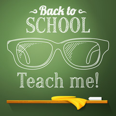 Nerd glasses on the chalkboard with back to school greeting.