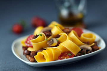 Italian pappardelle pasta with mushrooms
