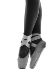 Close up of ballerina's shoes en pointe