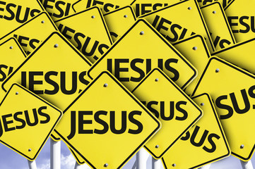 Jesus written on multiple road sign