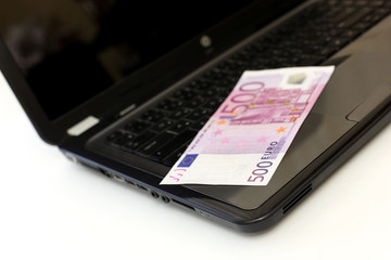 Five hundred euros on laptop keyboard