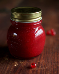 Homemade red currant jam or sauce in a jar
