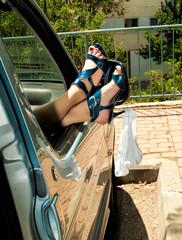girl putr feet out of car window