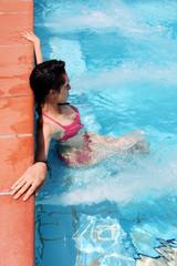 Sensual brunette with bikini in pool