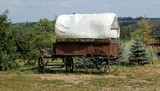 A side view of a stagecoach that was from the old west. poster