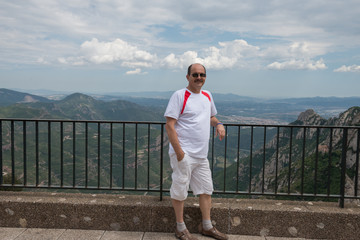 Mature man on  Llobregat valley background, Montserrat, Cataloni