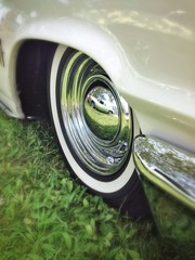 Classic car reflected in a wheel