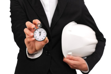 woman site manager holding a stopwatch