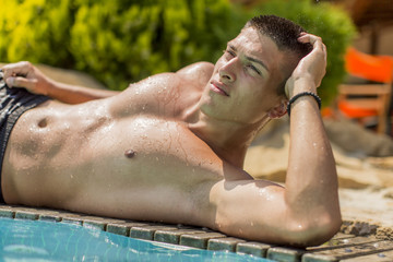 Young man by the pool