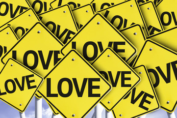 Love written on multiple road sign