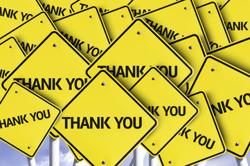 Thank you written on multiple road sign