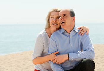Happy elderly couple hugging outdoor