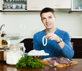guy cooking in home kitchen