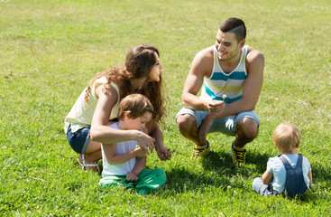 Family of four in sunny park