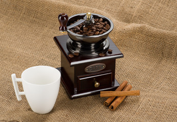 Coffee mill with cup on fabric