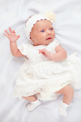 beautiful baby girl in white dress, three weeks old