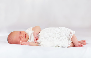beautiful infant baby girl sleeping, three weeks old