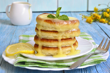 Pancakes with lemon sauce.