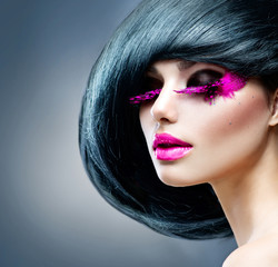 Fashion Brunette Model Portrait. Hairstyle. Professional Makeup