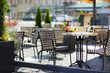Empty chiars in outdoor cafe on summer day - 68003232