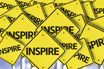 Inspire written on multiple road sign