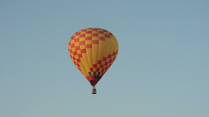 Colorful hot air balloon taking flight in the morning