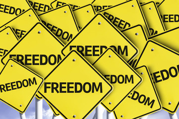 Freedom written on multiple road sign