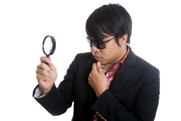 Asian man with magnifying glass