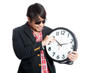 Asian man move minute hand clock and smile