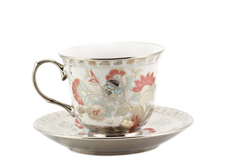 Vintage cup of tea on white background.