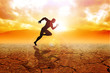 Silhouette of a sprinter running on drought land