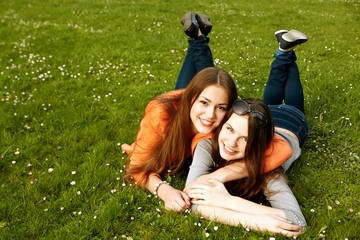 Women Lying On Grass