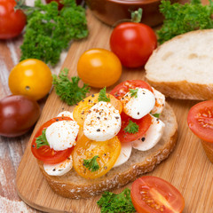 toast with mozzarella and colorful cherry tomatoes