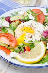 Vegetable salad with poached egg, vertical, closeup