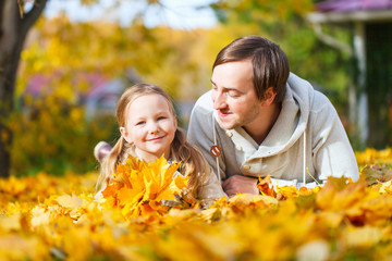Father and daughter outdoors at autumn day