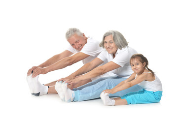 Senior couple exercising with granddaughter