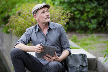 man in park with tablet