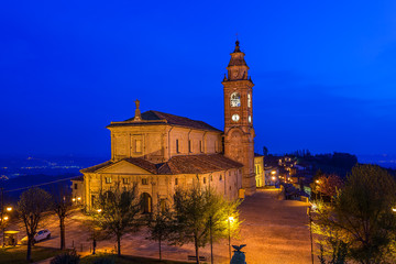 Catholic church illuminated at night.