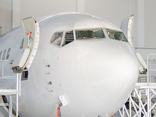 Passenger plane in the hangar. Aircraft maintenance.