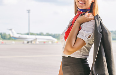 Stewardess on the airfield. Place for your text.