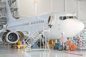 Passenger plane in the hangar. Aircraft maintenance.