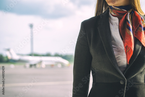 Stewardess on the airfield. Place for your text. - 68012439