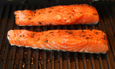 Marinated salmon fillets on the grill