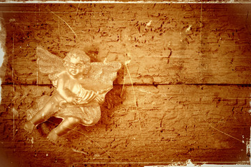 Angel in old wooden background