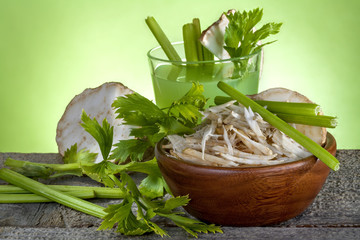 .Celery salad with celery juice on a wooden table