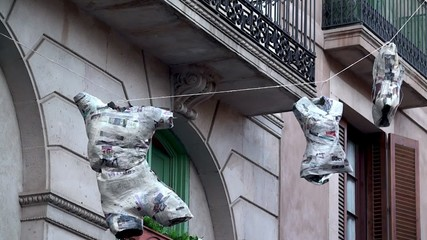 Art-installation in Barcelona. Mannequins with glued newspapers